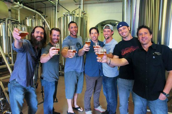 Stone Brewing Co. CEO Greg Koch poses with players from the San Diego Padres over some Operation Homefront IPA — with Greg Koch, Logan Forsythe, Kyle Blanks, John Baker (baseball) and Luke Gregerson at Stone Brewing World Bistro & Gardens - Liberty Station.