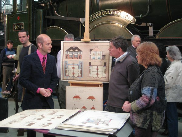 Marc Allum is intrigued by a collection of architectural plans.