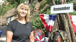Janet Mika is the woman behind the costumed dog statue on Madra Avenue.
