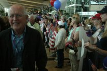 Jim Fudge, Navy veteran on Honor Flight, meets appreciative crowds at Lindbergh Field.
