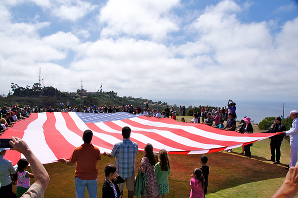 Attendees display a large American flag.