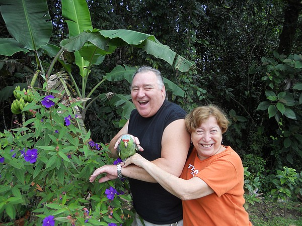 John and Blanca Dungan with their pet parrot.  At first, ...