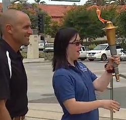 Special Olympian Lindsey Newman carries the torch of hope during Tuesday's ki...