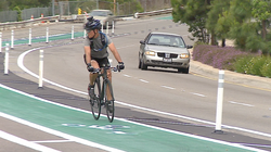 A cyclist rides in a new bike lane.