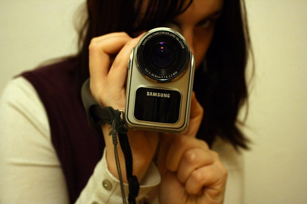Woman using camcorder