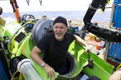 James Cameron emerging from the Deepsea Challenger, the one-man submarine he piloted nearly seven miles below the surface of the Pacific Ocean.