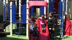 Rocio Turner's children enjoy playing on the playground at the YWCA Cortez Hi...