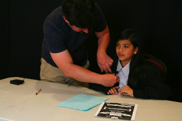 Artist David White works with a young San Diegan during his NCM workshop titl...