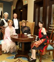 A team of greeters and actors in period costumes having tea as gala guests entered the cocktail reception, Saturday, May 4, 2013 at the US Grant, San Diego, CA.