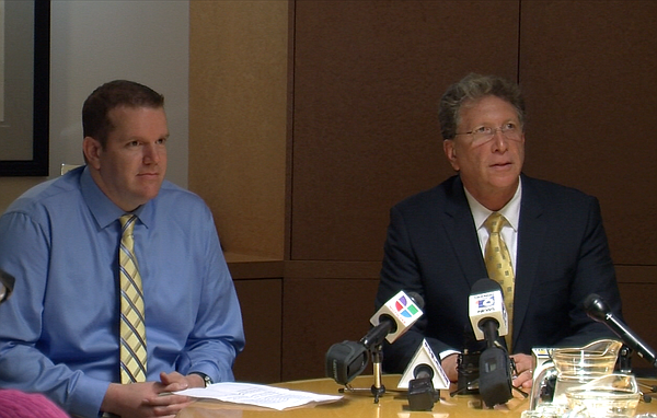Drew Belnap, left, and his lawyer, Irwin Zalkin, answer reporters' questions ...