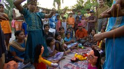Amlan Ganguly and the children putting on a puppet show about the need for cl...