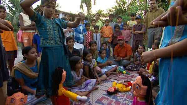 Amlan Ganguly and the children putting on a puppet show a...