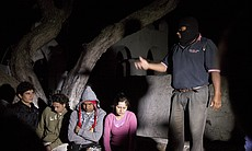 Before the start of the Caminata Nocturna tour. Simon, the guide, is addressing the students on the tour.