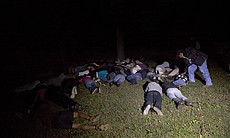Students on the ground during an encounter with...