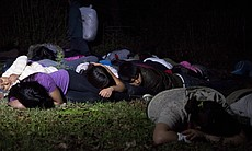 Students on the ground during an encounter with a fake violent drug smuggler.
