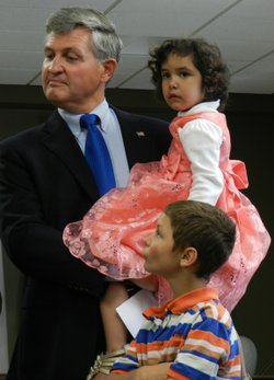 San Diego County Supervisor Dave Roberts with two of his children. Supervisor Roberts and his partner Wally Oliver have five adopted children.