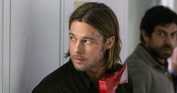 Gerry Lane (Brad Pitt) carries a perfectly awesome zombie smashing tool through a hallway of zombified disease specialists, which he never uses. That sliver of red at the bottom of the ax head is not blood, just part of the tool's design. And those are scratches on his face which also never bleed.   Jeez, all this blood talk is making me sound weird to myself. And this has turned out to be a long picture caption. Are you still reading this?