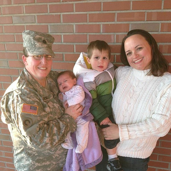 Army Lt. Col. Heather Mack, her wife Ashley Broadway, and their children.