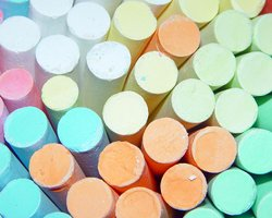Colorful sticks of sidewalk chalk.