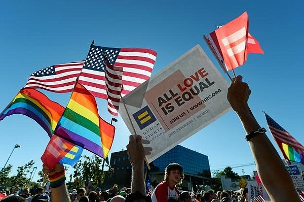 Same-sex marriage supporters celebrate the US Supreme Cou...
