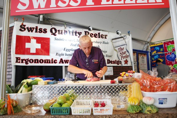 Larry Scheidt works his booth at the Del Mar Fair. He goes through 150 lbs of vegetables as he demonstrates throughout the day.