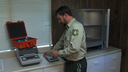 Forest Fuels Officer Stephen Fillmore weighs vegetation samples at the Descanso Forest Service Fire Station before placing them in an oven to cook away remaining moisture, June 27, 2013.