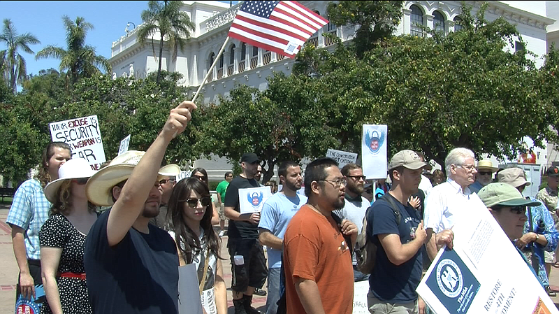 Protestors gather for the Restore the Fourth rally in Balboa Park.