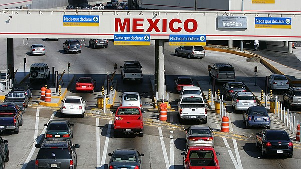 Cars cross into Mexico.