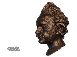 One of Wenman's prints of an Albert Einstein bust. He applied a bronze finish...