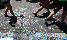 Rainbow confetti covered University Avenue in the San Diego Pride Parade, July 13, 2013.