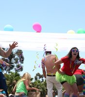 "San Diego Pride Parade participants on an Uptown Tavern and Energy 103.7 float dance to ""I Love It"" by Icona Pop, July 13, 2013."
