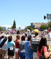 San Diego Pride Parade attendees view the stretch of participants and floats from the corner of University and 10th avenues, July 13, 2013.