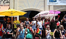 Attendees line University Avenue to watch the San Diego Pride Parade, July 13, 2012.