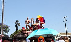 San Diego Pride Parade attendees enjoy the celebration from the top of a float, July 13, 2013.