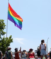 Spectators view the San Diego Pride Parade near its starting point at the rainbow flag on Normal Street, July 13, 2013.