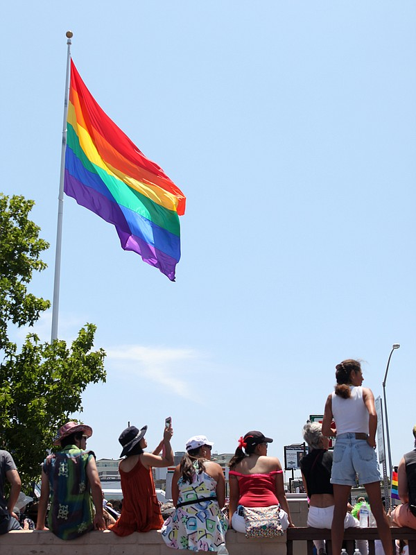 Spectators view the San Diego Pride Parade near its starting point at the rai...