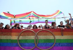 A float carrying participants in the San Diego Pride Parade waits its turn on...