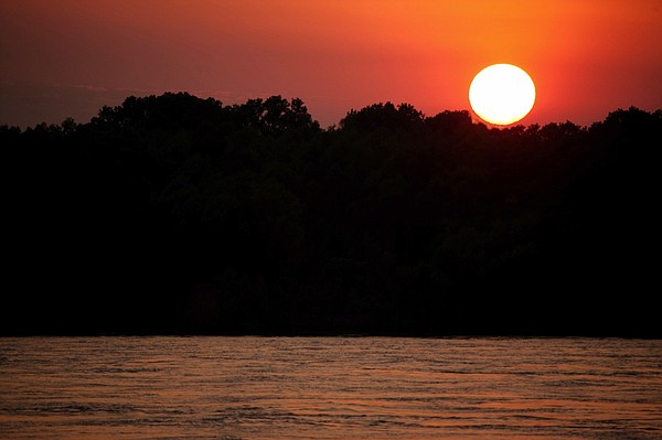 A view of the Mississippi River at sunset.