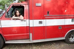 Schneider behind the wheel of the ambulance she drove cross-country to interv...