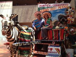 Reporter Jill Replogle poses with Roberto Lango, from the Tijuana preservation group Uni2, on one of Tijuana's iconic zonkeys.
