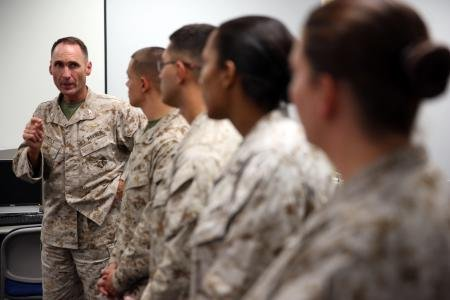 Col. Ernest L. Ackiss speaks to Marines on Cherry Point July 10 who recently earned Certified Logistics Associate and Certified Logistics Technician certificates.
