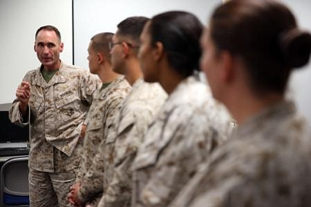 Col. Ernest L. Ackiss speaks to Marines on Cherry Point July 10 who recently ...