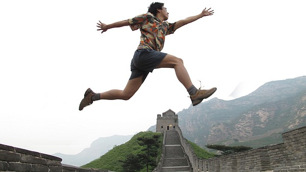 Zola leaps symbolically across the Great Wall of China.