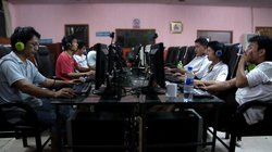 Zola at a local internet cafe in his hometown of Meitanba, Hunan Province.