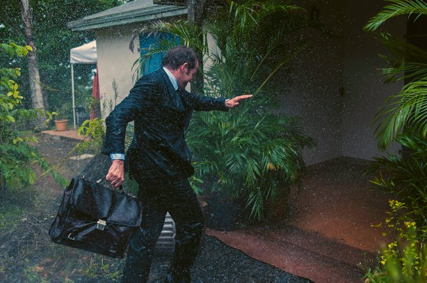 DI Richard Poole (Ben Miller) gets caught in the rain as Hurricane Irma approaches Saint Marie.