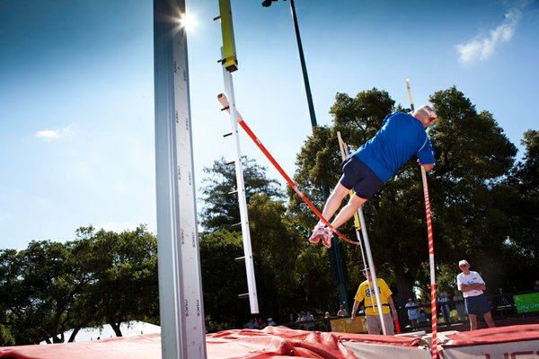 Adolph Hoffman, 86-year-old pole vaulter, in action.