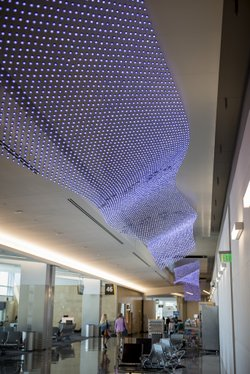 "Jim Campbell's ""The Journey"" lights the way through Terminal Two at San Diego International Airport."