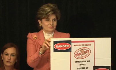 Attorney Gloria Allred holds up the warning sign she prop...