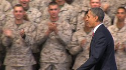 President Barack Obama walks to the podium to address the troops and their fa...