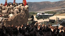 Marines look on as President Barack Obama's helicopter, Marine One, lands at ...